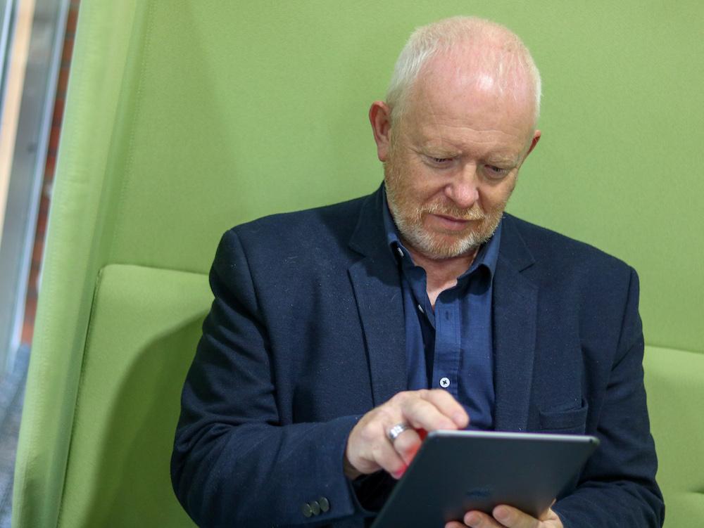 Mark Northall looking at iPad